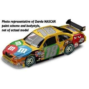 Kyle Buschs M&Ms #18 NASCAR UltraSpeed Car 1/64 Scale: Toys & Games