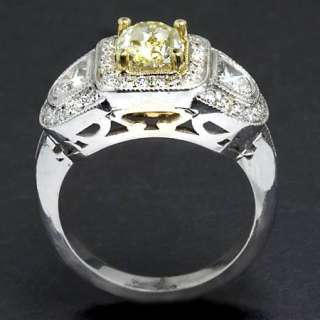 65 NATURAL FANCY YELLOW DIAMOND ESTATE COCKTAIL RING