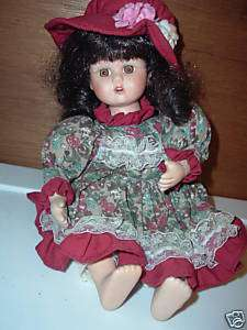 ANCO DOLL PORCELAIN, WIND UP ARMS MOVE & PLAYS SONG