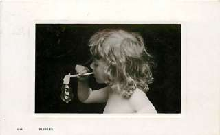 REAL PHOTO CUTE LITTLE GIRL BLOWING BUBBLES MAILED 1907 R47391