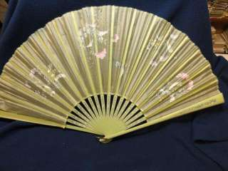 Lovely antique hand painted silk ladies fan. Light green celluloid