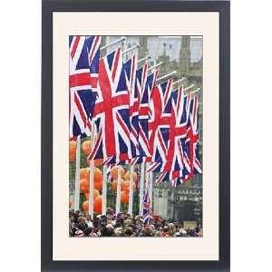 Union flags and spectators outside Houses of Parliament