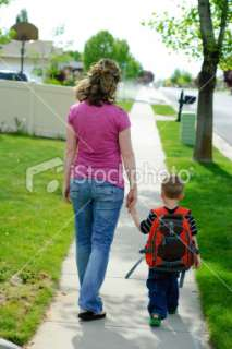 Mother walking new child to school Royalty Free Stock Photo