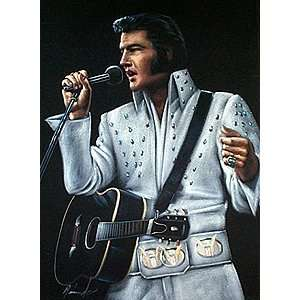 Velvet Elvis Presley in White Jumpsuit Singing into the Mic with