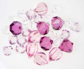 oz. Acrylic Sparkling Assorted Shaped Light to Dark Purple Gems give
